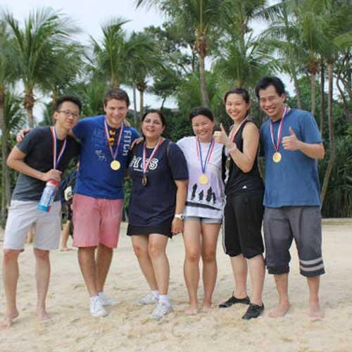 staff team on the beach.