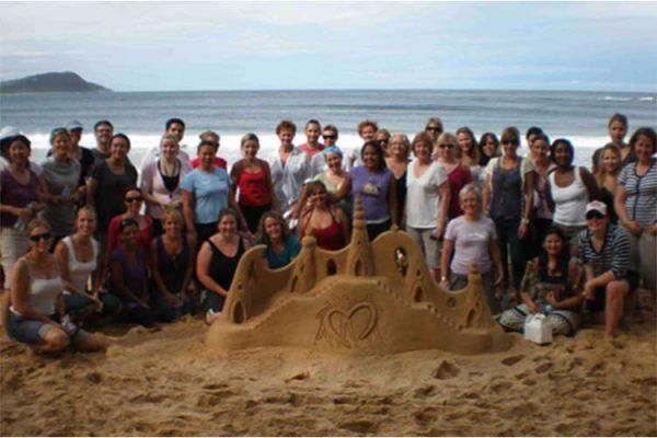 Sand sculpture teamwork on the beach.