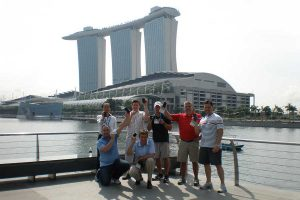 Staff group by the water in Singapore.